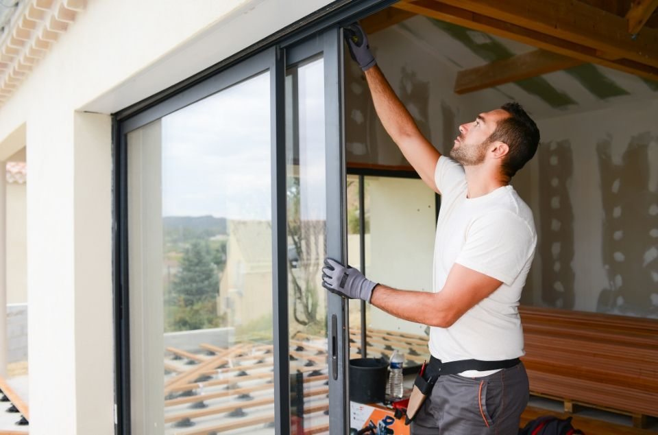Man Installing Sliding Glass Door
